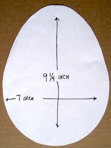 Draw the egg pattern onto the 9 x 12 piece of felt and cut it out.