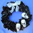 black-news-wreath-skulls-done-240x234
