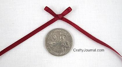 tie-tiny-bow15w-420x232