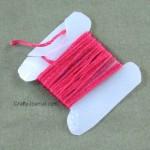 Embroidery Thread Bobbin from a Milk Jug