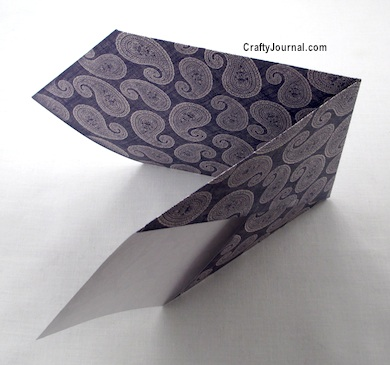 refold on the score lines as shown. Crease. Fold 6 Pockets from 1 Sheet of Paper by Crafty Journal