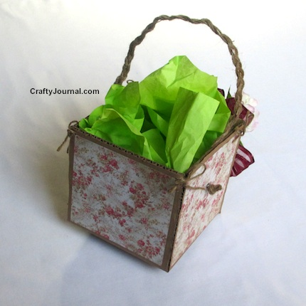 Create a rustic basket from the side of a cardboard box.